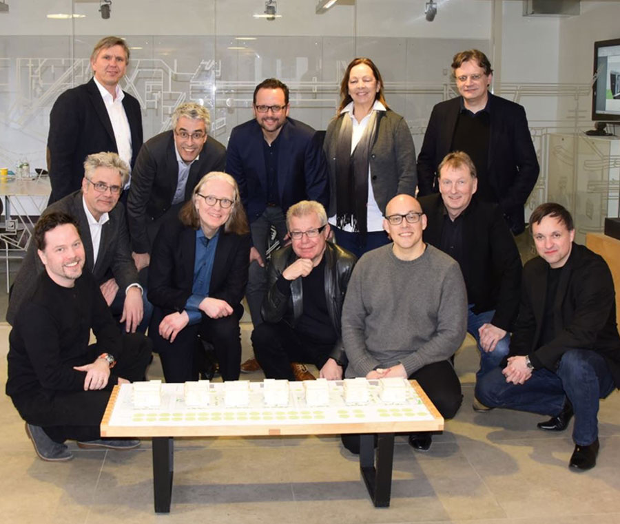 Group photograph of the project team in Studio Libeskind, New York – front row from left to right: Sascha Manteufel (architect at Studio Libeskind), Carsten Dulz (Dulz Architekten – construction planning and site management), Werner Hackermeier (consens development GmbH – project development), Daniel Libeskind, Neil Cook (architect at Studio Libeskind), Werner Schick (sales and project leader at LECHNER GROUP), Stefan List (sales advisor at LECHNER GROUP). Back row from left to right: Franz Leckel (atelier8 - geomancy), Stefan Blach (principal architect/project leader at Studio Libeskind), Georg Bellinger (Tragwerk – structural engineering), Barbara Jurk (atelier 8 – garden and landscape planning), Arnault Biou (architect at Studio Libeskind)
